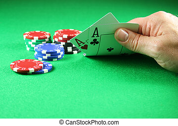 Poker - A Pair of Aces with Poker Chips - A player showing a...