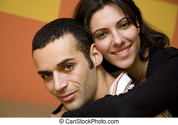 the sweatest thing - man and woman smiling and holding each...