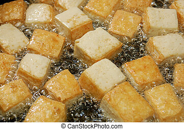 tofu - cutting tofu in boiling oil