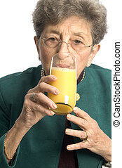 woman with oj - ooh a nice glass of orange juice for a...