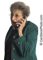 senior woman on phone - shocked angry senior woman on...