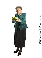senior woman with apple - attractive senior woman business...