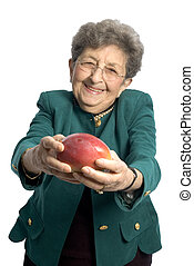 senior woman with mango - attractive senior woman business...