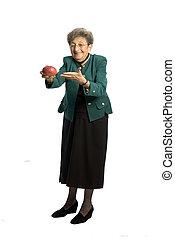 senior woman with mango - attractive senior woman business...