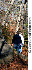 Gay Couple - Young maile gay couple walking alone in the...