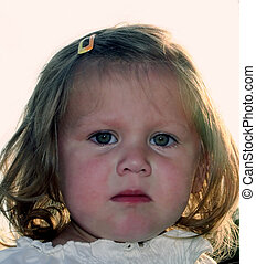 EmotionalLittleGirl - Closeup of the emotional face of a...