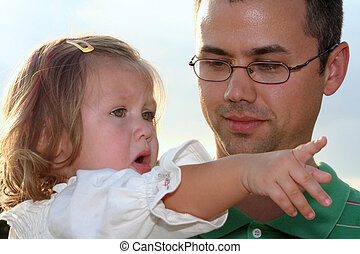 ExplainingItAllToDad - Little girl pointing with sad...
