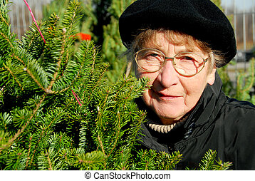 Senior woman at the Christmas tree market