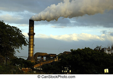 Sugar Mill - Picture of a smokey sugar mill on a bright...