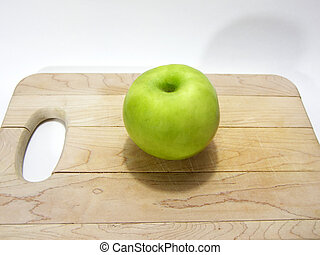 Apple on Cutting Board - Photo of an apple on a cutting...