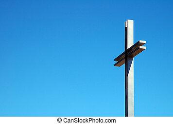 steel cross - detail photo of a steel cross, blue sky,