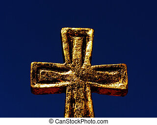 golden cross - Close-up of golden cross with decoration...