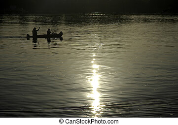 kayak paddling - boy and his mother paddling on a kayak,...