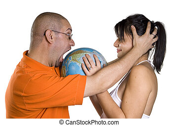 Couple and globe - Man and woman holding globe of world on...