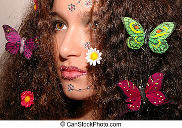 Butterfly Girl - Girl wearing makeup made of rhinestone...