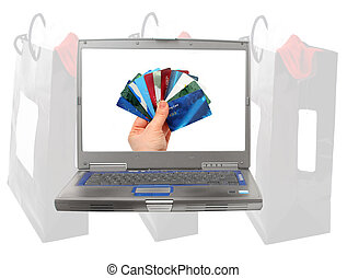 online shopping - computer with images of shopping bags and...