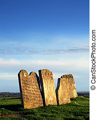Gravestones - Very old gravestones by a ruined church in...