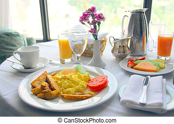 Breakfast for two served in a hotel room