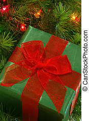 Christmas Gift - A green fabric wrapped gift with a bright...