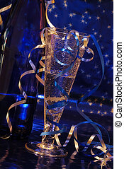 New Year Toast - Crystal champagne flute and blue bottle of...