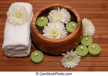 Spa Scene - Floating green candles, chrysanthemum, towels on...
