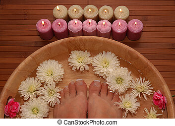 Foot Bath - A pair of pedicured feet in a bowl full of water...