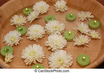 Aroma therapy - Floating green candles and chrysanthemum in...