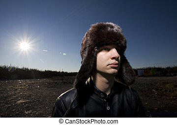 winter sun - guy staring at the horizon in a lonely location