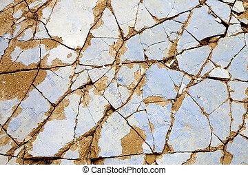 Broken wall - A close-up of an old broken wall