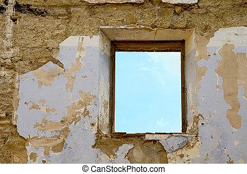 Aged window - A broken window in an aged wall