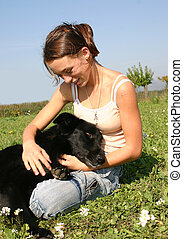 friendship teen dog - happy teenager with her black dog