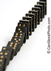 Black Dominoes Falling Down in a Line - A line of black...