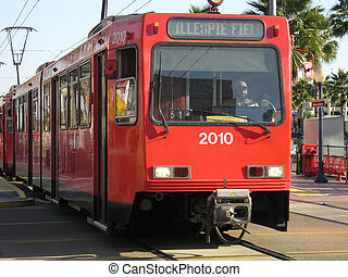 San Diego red trolley on tacks