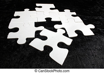 blank jigsaw - blank white jigsaw puzzle on black background