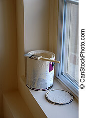 Paint Brush and Can - An open can of paint is sitting on a...