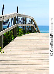 Beach view - Wooden path over sand dunes with ocean view