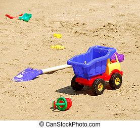 Beach toys - Children\\\'s sand plastic toys on a beach
