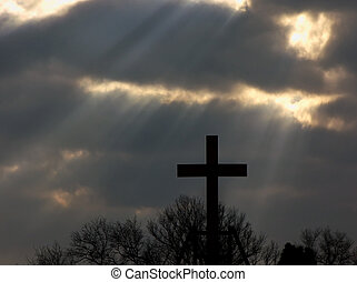 Kingdom Come - Photo of a silhouetted cross against dark...