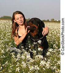 teen and dog - sitting teenager and her purebreed rottweiler