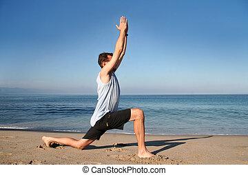 Beach yoga - Man doing yoga exercise on the beach