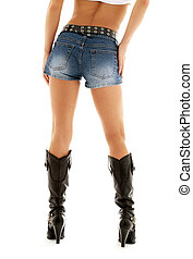 cowboy boots and denim shorts - long legs in cowboy boots...