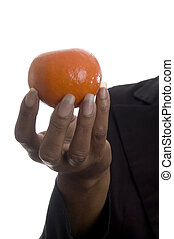 woman with tangerine - beautiful black woman with fresh...