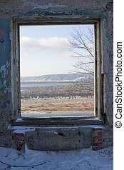 window from winter to spring - window in the old abandoned...