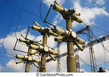 Sky and electricity - Electrical wires and isolators on the...