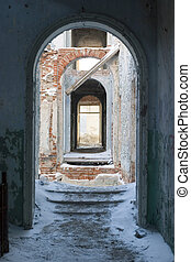 old archway - archway in the abandoned building and snowy...