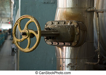 big valve - industrial facility with closeup of big pipe and...