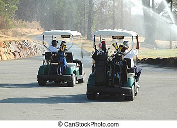 Golf Carts - Photographed golf carts going through sprinkler...