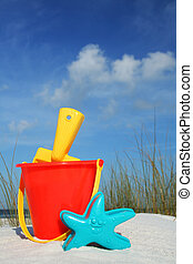 Beach Bucket and Spade - Bucket and Spade on the seashore