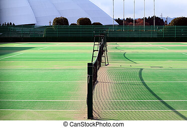 Tennis court - Image of a tennis court and a sports hall in...