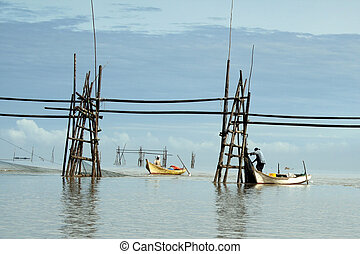 Fishermen in Bako - Fishermen setting up nets across the...
